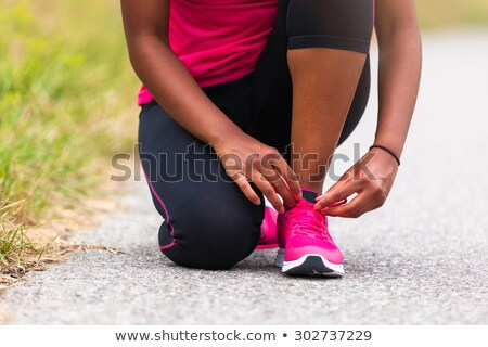 close up portrait of a sports african woman running stock photo © deandrobot