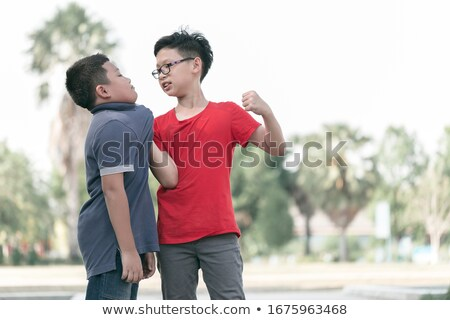 Boys fighting and getting hurt Stock photo © bluering