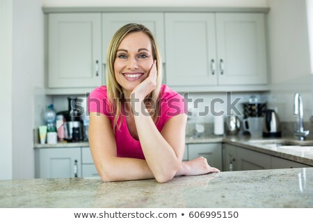 happy blonde woman in the kitchen Stock photo © ssuaphoto