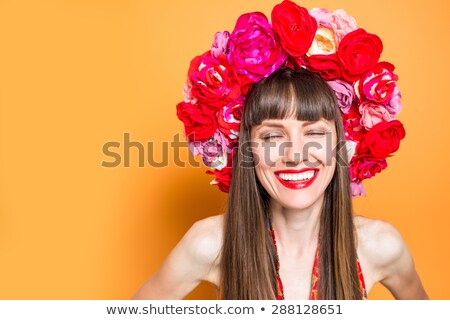 beautiful brunette wearing flowers hat stock photo © konradbak