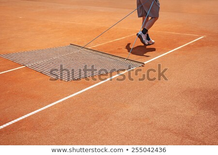 Worker Repairing lines on a tennis court Stock photo © smuki