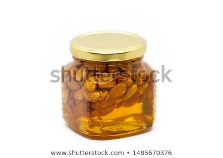 Lemons and glass jar with almonds and lemons Stock photo © homydesign