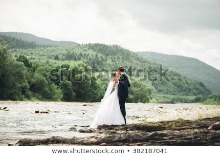 ślub · para · jezioro · brzegu · stwarzające · kobieta - zdjęcia stock © tekso
