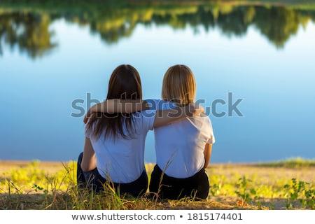 Blonde romantic woman in the park near river Stock photo © artsvitlyna