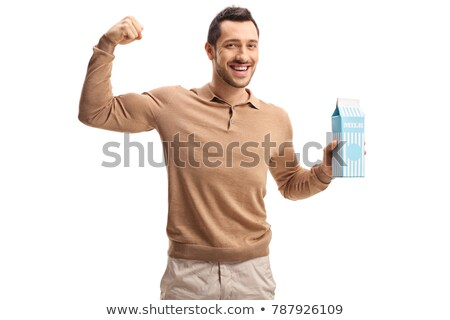 smiling young man flexing his biceps  Stock photo © feedough