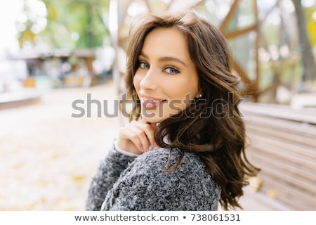Attractive young woman with beautiful big eyes looking at camera Stock photo © LightFieldStudios