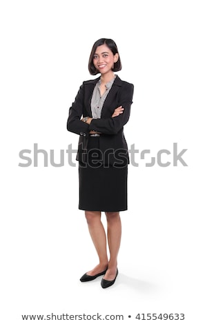 happy business woman standing with legs crossed  Stock photo © feedough