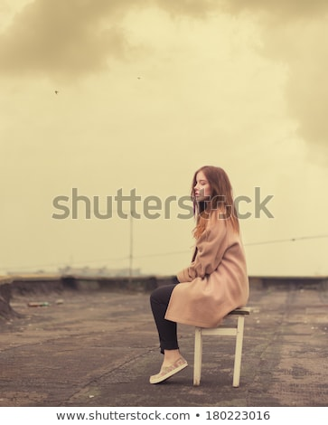 sad beautiful young woman sitts on stool Stock photo © feedough