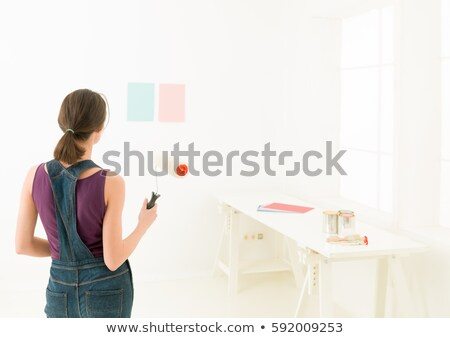 woman painting colour swatches on wall stock photo © is2