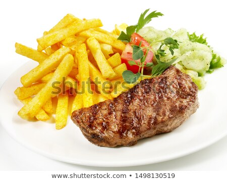 Steak with fries and salad on the plate Stock photo © bluering