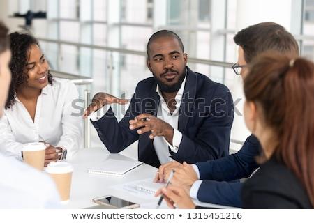 Business meeting ablack men in office Stock photo © studioworkstock