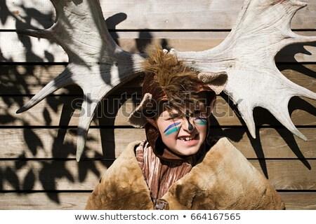 Fiú felfelé medve jávorszarvas agancs gyermek Stock fotó © IS2