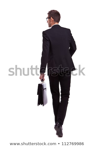 back view of businessman with suitcase walking stock photo © feedough