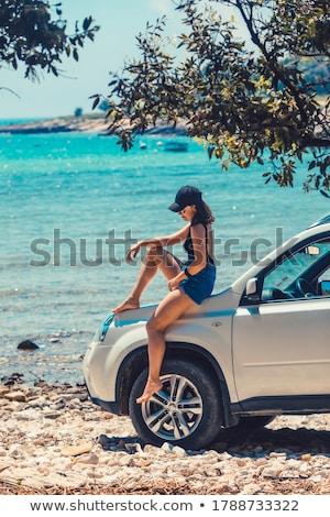 Mulher sessão suv caminhão sorridente transporte Foto stock © IS2