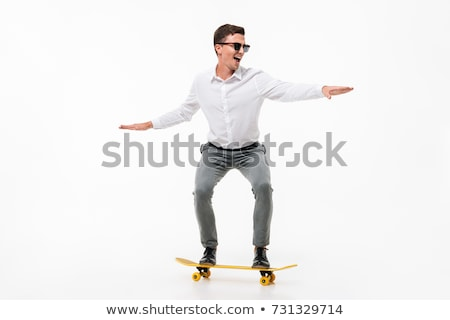 Businessman with skateboard isolated on white background Stock photo © Elnur