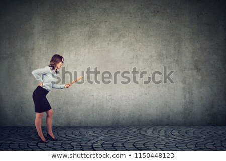angry young woman with rolling pin screaming at someone stock photo © ichiosea