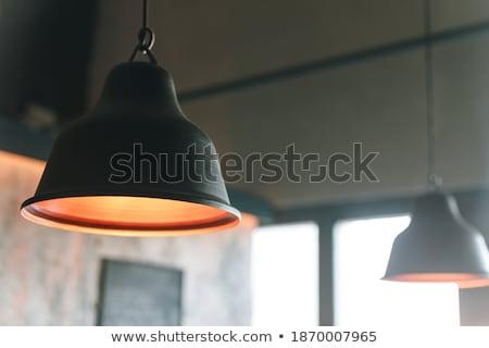 Escuro metálico lâmpada enforcamento cinza parede Foto stock © bezikus