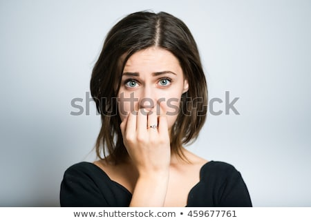 Stok fotoğraf: Portrait Of An Upset Young Woman Isolated