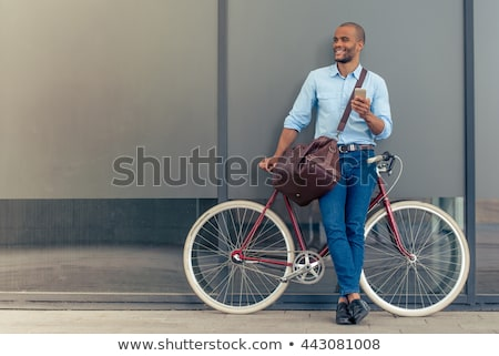 Full length portrait of a smiling young afro american man Stock photo © deandrobot