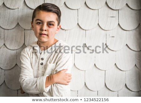 Sad and Afraid Mixed Race Boy With Bruises and Black Eye Stock photo © feverpitch