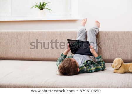 wenig · Junge · Tablet · Sitzung · Sofa · Kind - stock foto © Lopolo