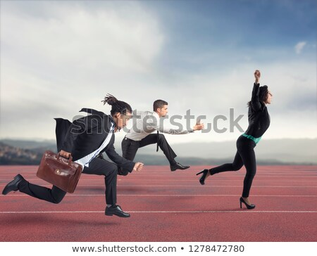 Businesswoman wins a run contest against the competitors. Concept of success Stock photo © alphaspirit