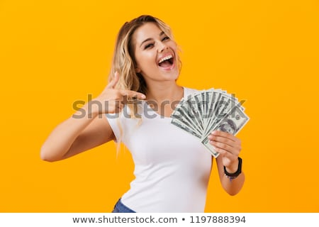 Photo of charming woman in basic clothing holding fan of dollar  Stock photo © deandrobot