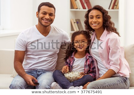 attractive child girls in casual clothes watching TV at home Stock photo © Lopolo