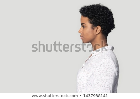 Thoughtful attractive fashionable young woman Isolated on gray background Stock photo © studiolucky