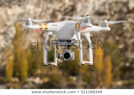 Drone flying on clear day Stock photo © adamr