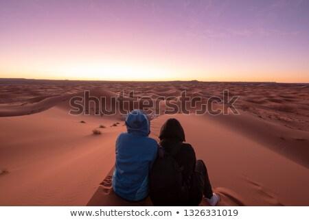 Silhouette uomo sabbia primo piano mano Foto d'archivio © nito