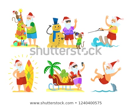 Santa Claus and Monkey Decorating Umbrella Snowman Stock photo © robuart