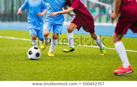 Fiatal futball játékosok fut futballabda futball Stock fotó © matimix