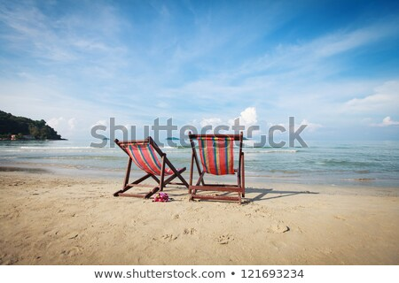 Blue And Red Chairs On Sandy Beach Stock photo © AndreyPopov
