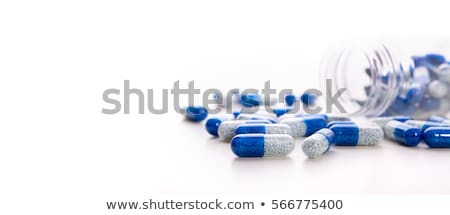 Pile of pills on blue Stock photo © neirfy