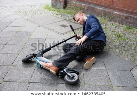 Fiatalember baleset elektromos moped utca férfi Stock fotó © AndreyPopov