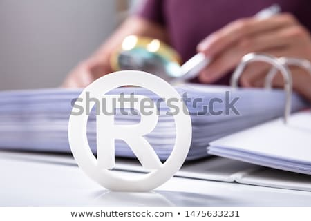Fehér regisztrált védjegy felirat iratok közelkép Stock fotó © AndreyPopov