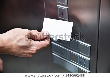 person holding key card near elevator button stock photo © andreypopov