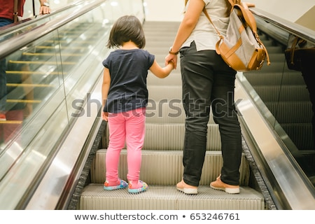 Mother And Daughter Moving Down On Staircase Stock photo © AndreyPopov