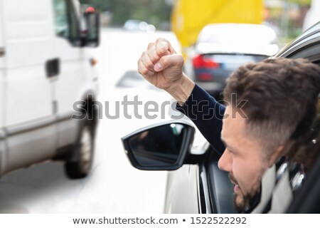 Man Clenching His Fist Looking Out Through Car Window Stock photo © AndreyPopov