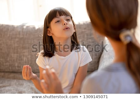 speech therapist helps the girl to pronounce the sounds stock photo © andreypopov