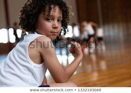 Oldalnézet iskolás fiú mutat bicepsz néz kamera Stock fotó © wavebreak_media