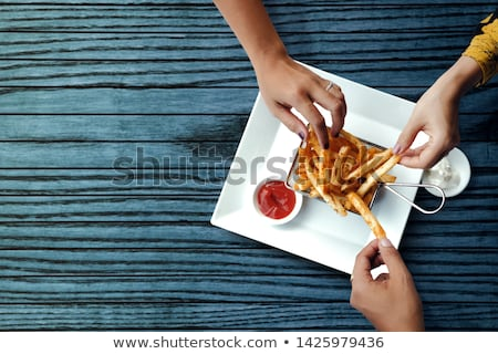 Woman hands and yellow potatoes on table - top view Stock photo © lightkeeper