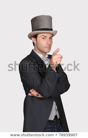 jonge · goochelaar · hoog · hoed · zwarte · hand - stockfoto © vladacanon