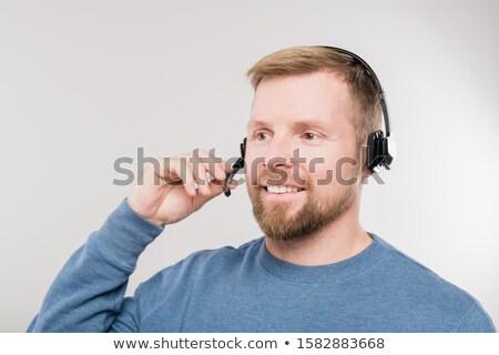 Genç hattı operatör kulaklık mavi Stok fotoğraf © pressmaster