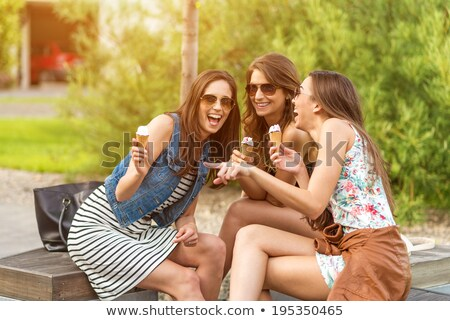 Cute young woman in an ice cream parlor Stock photo © lightpoet