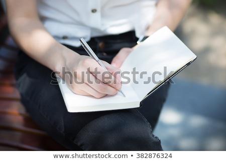 Diák lány napló notebook könyvtár oktatás Stock fotó © dolgachov