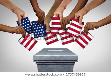 Votação diversidade diverso mãos cédula estação Foto stock © Lightsource