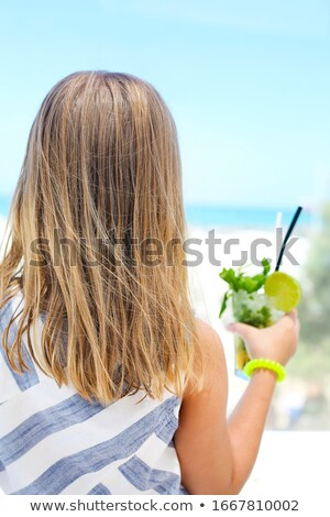 Anonymous girl with mojito on beach Stock photo © dashapetrenko