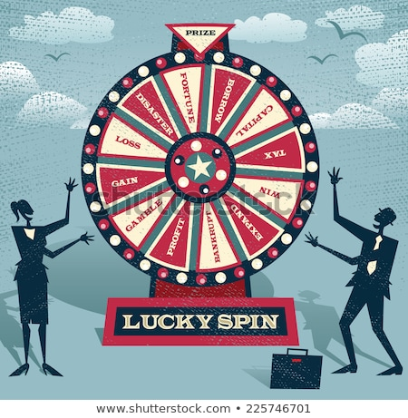 Woman Spins Fortune Wheel, Gamble Game of Chance Stock photo © robuart
